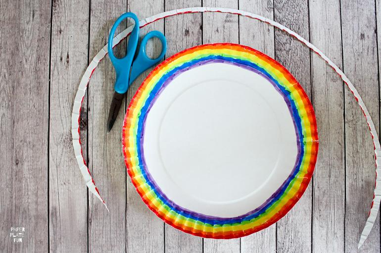 Paper plates become rainbow pencil toppers in this fun back to school craft.