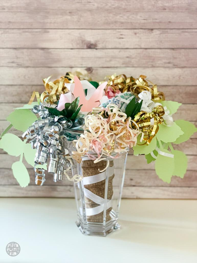 Attention maids-of-honor! Learn how to make the prettiest bridal shower bow bouquet for the wedding rehearsal with paper plates and these simple steps! This bow bouquet is gorgeous!