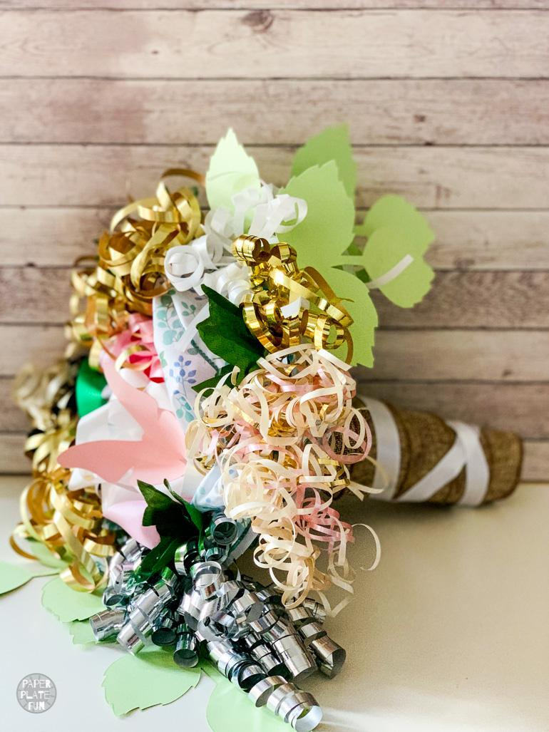Learn exactly how to make a beautiful bouquet from ribbons and bows from the bridal shower! This post shows you just how to do it!