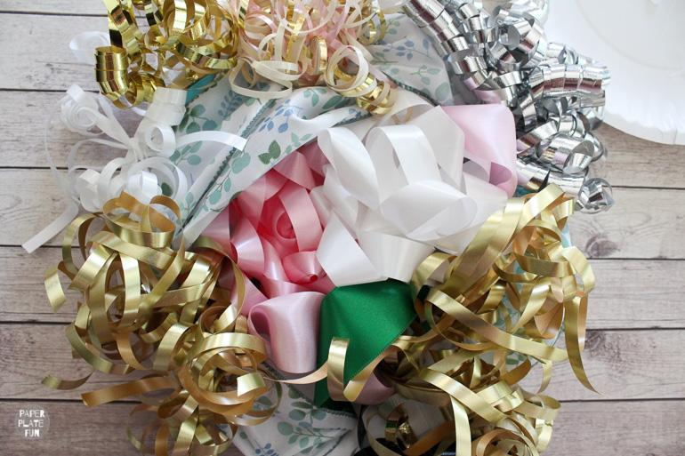 This post shows you how to use bows and ribbon from the bridal shower to create a bouquet for the wedding rehearsal.