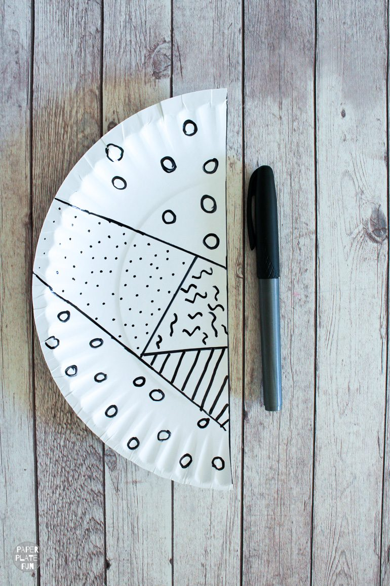 Use a permanent marker to create a bold paper plate craft.