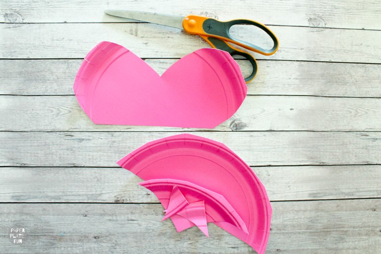 Cut the paper plate to form the top half of a heart.