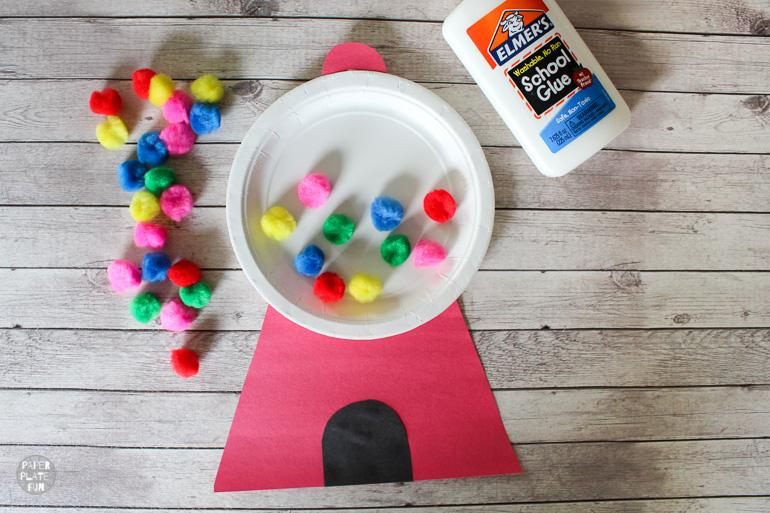 Kids love using pom poms to make this adorable gumball machine craft.