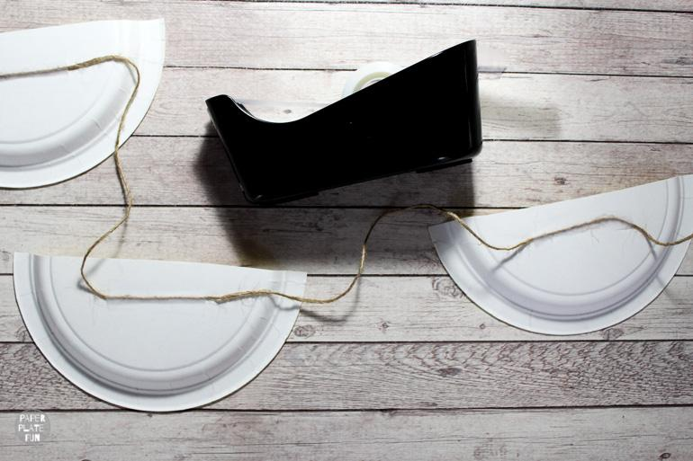 Tape the twine to the backs of the lemon paper plates.