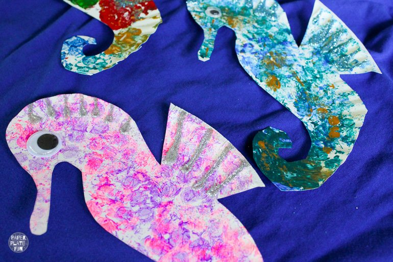 Paper plate seahorses in a herd are a fun summer craft or ocean craft for kids.
