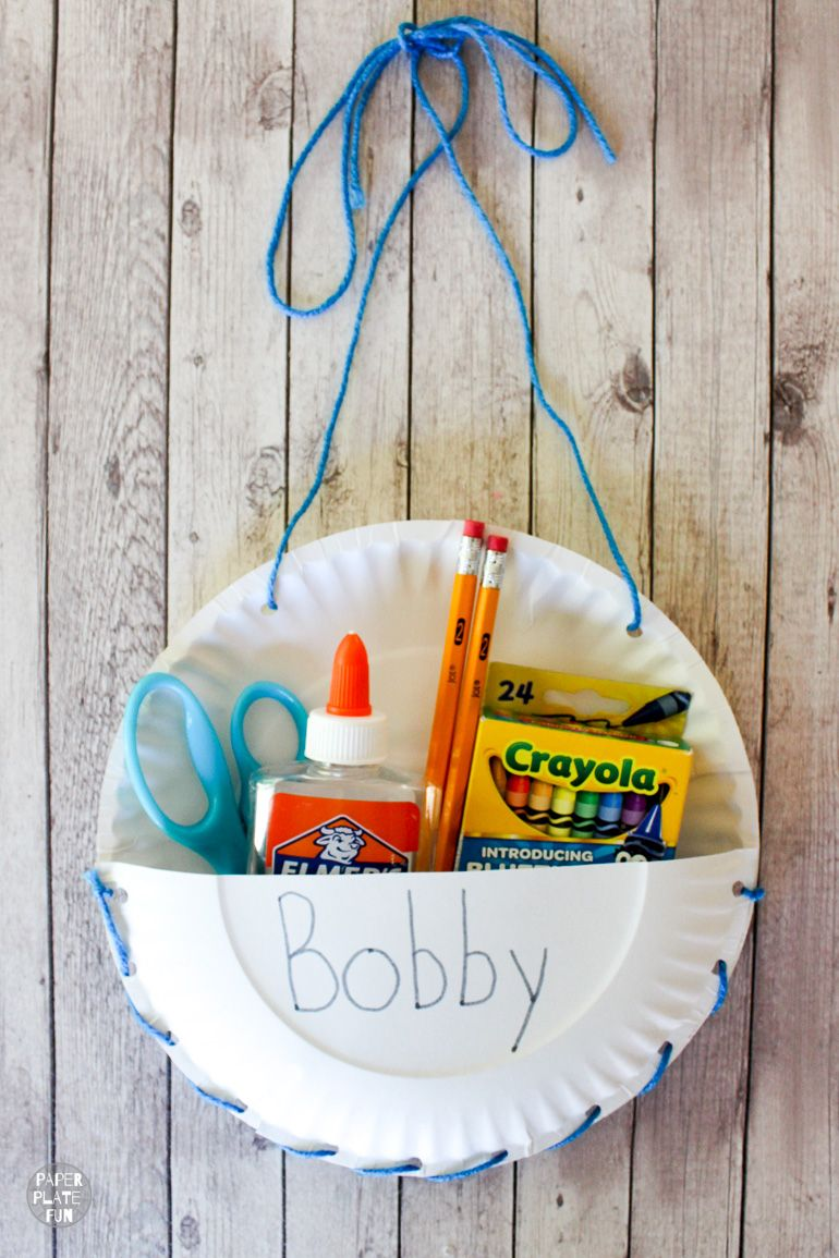 Brilliant! See how she used paper plates to make DIY seat sack chair organizers for her classroom!