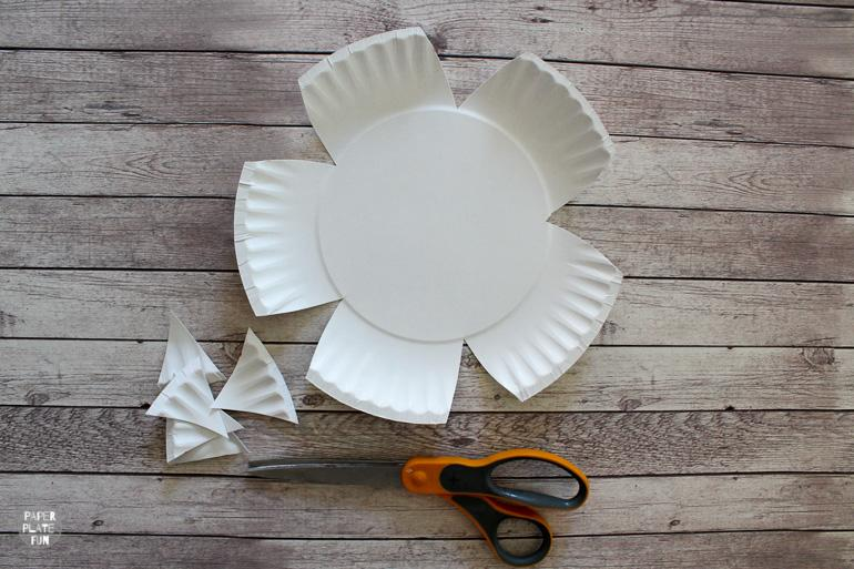 With just two paper plates you can make paper plate flowers! Learn how in this post.