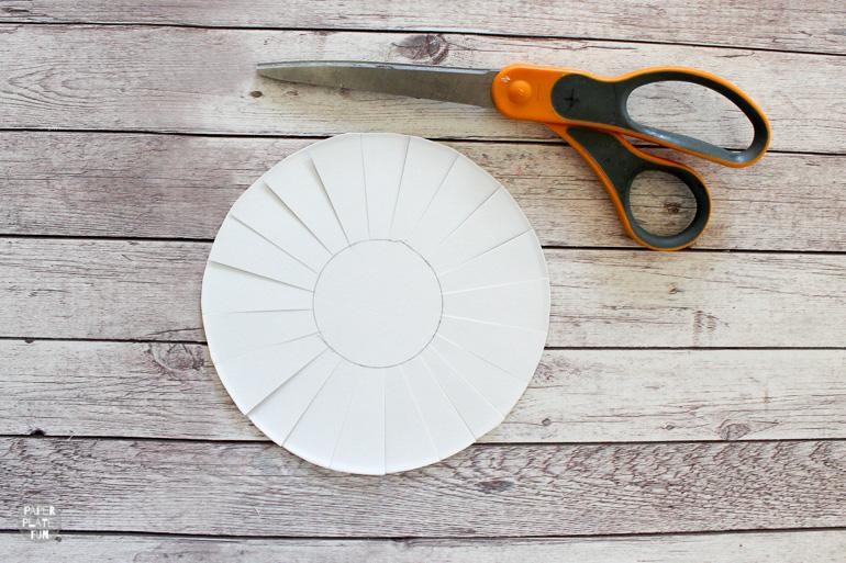 Cutting fringe in the paper plate helps make for a 3D paper plate flower.