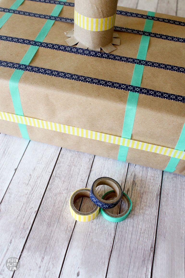 Decorate the recycled ring toss game with colorful washi tape.