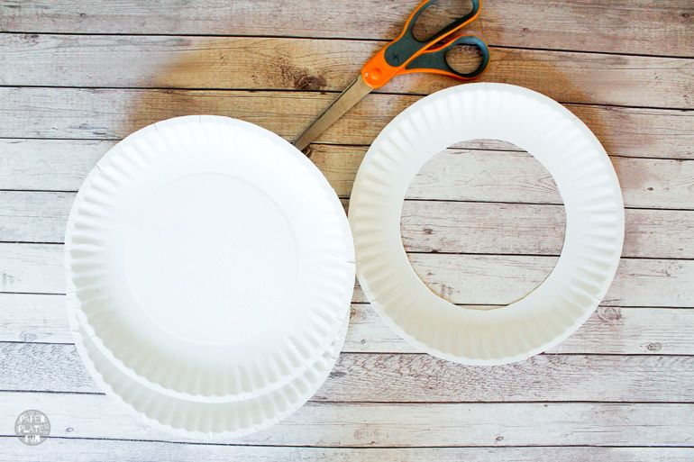 Make flying rings for recycled ring toss with paper plates.