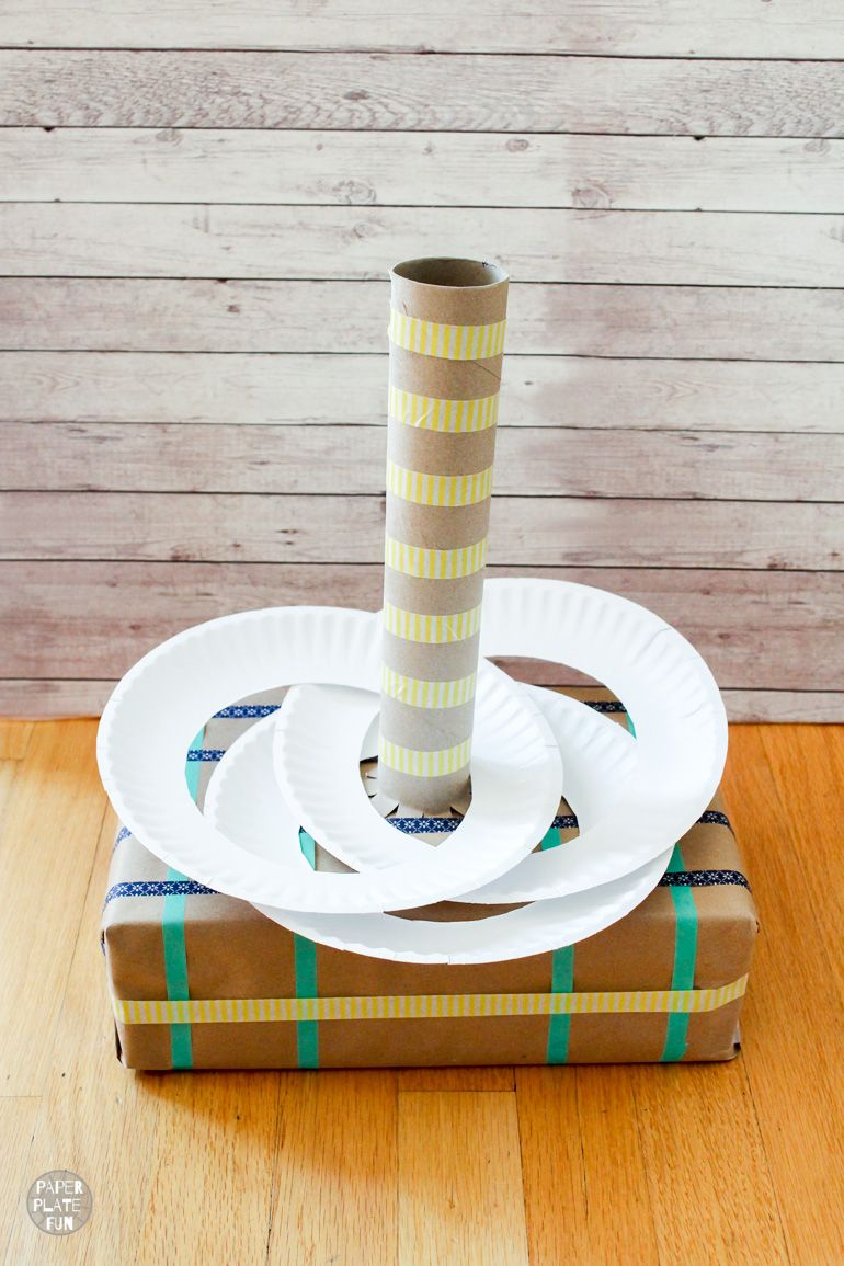 Make this recycled ring toss game with supplies from the recycling bin, like boxes and paper plates! It's a great class party game or activity to keep the kids entertained!