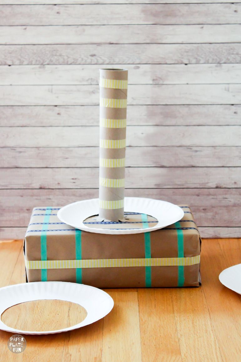 Make this recycled ring toss game with supplies from the recycling bin, like boxes and paper plates! It's a great class party game or activity to keep the kids entertained! This DIY game is sure to be a hit.