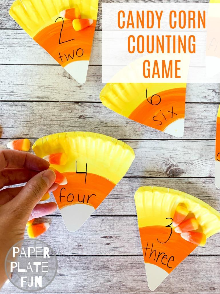 This easy preschool Halloween game is fun and educational! Giant candy corn pieces and real candy corn make for a fun counting game that's perfect for Halloween class parties and more.