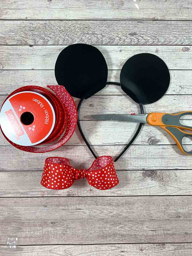Red polka dotted ribbon helps transform Mickey Mouse ears into Minnie Mouse ears!